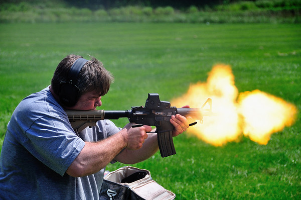 This little AR-15 was modified to created a huge muzzle flash. I don't know how it was done. This image has NOT been Photoshopped. It took me 5 tries with my Nikon D300 shooting at 6 frames per second to catch this.